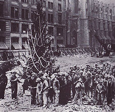 The first Tree at Rockefeller Center, erected by construction workers in 1931 shortly after the site was cleared