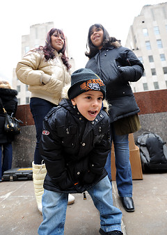 Ester Huambo (l.) and her kids, Dalila, 12, and Jose, 4, will be living with the Rockefeller Center Christmas tree all year long; the lumber is being used for Habitat for Humanity housing.