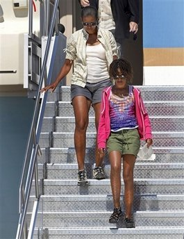 First lady Michelle Obama walks down the stairs of Air Force One with her daughter Malia Obama, 11, Sunday, Aug. 16, 2009 at Sky Harbor International Airport in Phoenix. The Obama's were returning from a trip to the Grand Canyon.